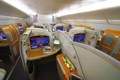 Emirates Airbus A380 interior. BANGKOK, THAILAND - MARCH 31, 2015: Emirates Airbus A380 interior. Emirates is one of two flag carriers of the United Arab Stock Photos