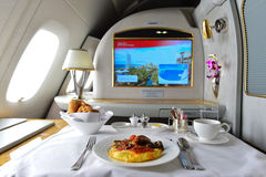 Emirates Airbus A380 interior. DUBAI, UAE - MARCH 31, 2015: Emirates Airbus A380 interior. Emirates is one of two flag carriers of the United Arab Emirates along Royalty Free Stock Photography