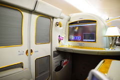Emirates Airbus A380 interior. DUBAI, UAE - MARCH 31, 2015: Emirates Airbus A380 interior. Emirates is one of two flag carriers of the United Arab Emirates along Stock Photos