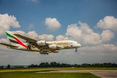 Emirates Airbus A380 landing at Franz Josef Strauss Airport Munich MUC. Munich - JUNE 08, 2018: Emirates Airbus A380 landing at Franz Josef Strauss Airport Stock Photos