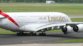 Emirates Airbus A380 taxiing. Dusseldorf, Germany - July 23, 2017: Emirates Airbus A380 A6-EOB taxiing before departure. Dusseldorf Airport, Germany stock footage