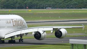 Emirates Airbus A380 taxiing. Dusseldorf, Germany - July 23, 2017: Emirates Airbus A380 A6-EOB taxiing before departure. Dusseldorf Airport, Germany stock video footage