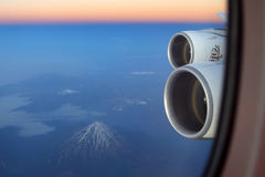 Emirates Airbus A380 wing view, Damavand volcano seen. IRAN - JUNE 25, 2014: Emirates Airbus A380 wing view, Damavand volcano seen Stock Image