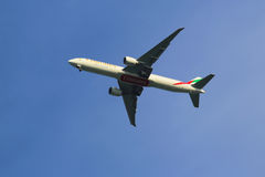 Emirates Airline Boeing 777 in New York sky before landing at JFK Airport Stock Images
