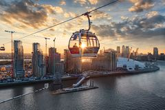 The Emirates Airline cable car crosses the Thames of London during sunset stock photos