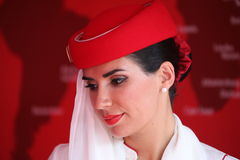 Emirates Airline flight attendant at the Billie Jean King National Tennis Center during US Open 2015. NEW YORK - SEPTEMBER 1, 2015: Emirates Airline flight Stock Photos