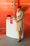 Emirates Airline flight attendant at the Emirates Airline booth at the Billie Jean King National Tennis Center during US Open 2013 Royalty Free Stock Photos