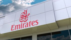 Emirates Airline logo on the modern building facade. Editorial 3D rendering. Emirates Airline logo on the modern building facade. Editorial 3D stock footage