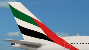 Emirates airline plane, logo close-up. Stock Photo