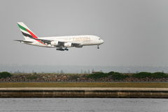 Emirates Airlines Airbus A380 about to land. Emirates Airlines Airbus A380 about to touchdown in Sydney, Australia Royalty Free Stock Image