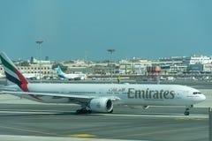 Emirates Airlines Airplane drives through Dubai International Airport stock photos