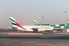 Emirates Airlines jumbo jet aircraft at Dubai International Airp Stock Photos