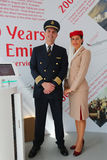 Emirates Airlines pilot and flight attendant at the Emirates Airlines booth at the Billie Jean King National Tennis Center Stock Images