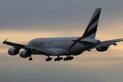 Emirates A380 plane flying up in the sky, dusk stock images
