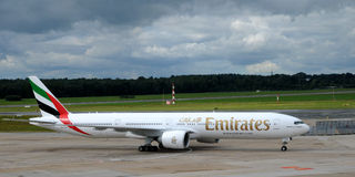 Emirates Boeing 777  in airport Hamburg. The Boeing 777 300 ER  is a long-range wide-body twin-engine jet airliner manufactured by Boeing Commercial Airplanes Royalty Free Stock Photos