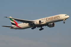 Emirates Boeing B777 landing. Emirates is the flag carrier of Dubai. The company is growing fast with a current (Aug'13) fleet of over 200 aircrafts but almost Royalty Free Stock Images