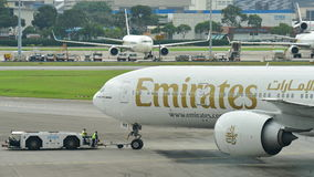 Emirates Boeing 777-300ER being pushed back at Changi Airport Stock Photos