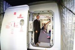 Emirates crew member meet passengers Royalty Free Stock Photo