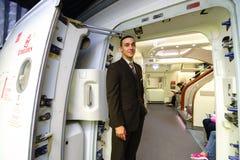 Emirates crew member meet passengers Stock Photo