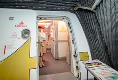 Emirates crew member meet passengers on second floor of A380 Stock Photos