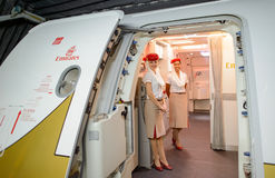 Emirates crew member meet passengers on second floor of A380 Royalty Free Stock Photos