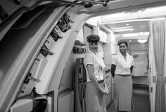 Emirates crew member meet passengers on second floor of A380 Stock Image