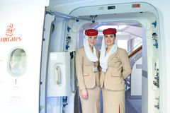 Emirates crew members meet passengers Royalty Free Stock Photo