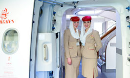 Emirates crew members meet passengers Royalty Free Stock Photos