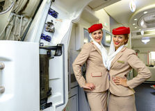 Emirates crew members meet passengers Royalty Free Stock Images
