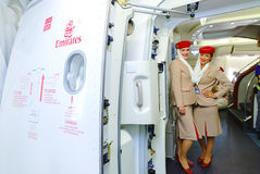 Emirates crew members meet passengers Stock Images