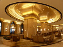 Emirates Palace interior of 24 carat gold plates capital. Doric like capital of column in new golden style with 24 carat gold plated oval top slab enlargement Royalty Free Stock Photos