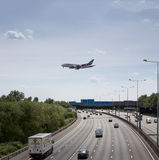 Emirates plane over M25 landing at Heathrow. Emirates A380 crossing M25 motorway on approach to Heathrow airport.  If approved, Heathrows preferred option for a Royalty Free Stock Image