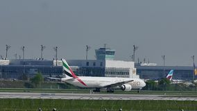 Emirates plane doing taxi on Munich Airport, MUC. Emirates Airlines jet, taxiway on Munich Airport, Germany stock footage
