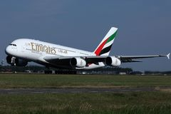 Emirates A380 plane takes off from AMS Airport, Netherlands. Emirates jumbo plane takes off from Schiphol Airport royalty free stock photography