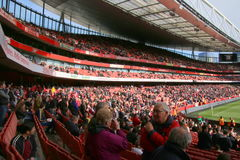 Emirates Stadium. The Crowd cheers on Arsenal vs. Norwich City Royalty Free Stock Photos
