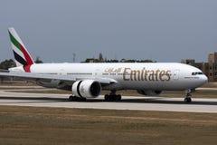 Emirates 777 in thrust reverse. Luqa, Malta - 1 June 2008: Emirates Boeing 777-31H/ER [A6-EBR] landing runway 14 Stock Images