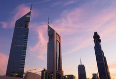 Emirates towers at dusk. View of emirates tower from sheikh zayed road at dusk Stock Image
