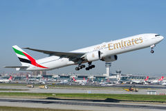 Emiratos de A6-EBV, Boeing 777-31HER Fotografía de archivo