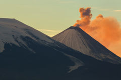 Emission ash from a volcano Klyuchevskoy dawn rays of sun. Royalty Free Stock Image
