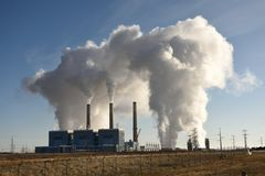 Emission clouds rising from a coal-fired steam electric generating power plant, Laramie River Station. In Wheatland, Wyoming stock image