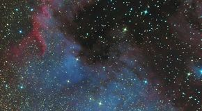 Emission nebula of North America in the constellation Swan and is a region of ionized hydrogen. Photo of the nebula and the star f. Ield through the telescope royalty free stock photo