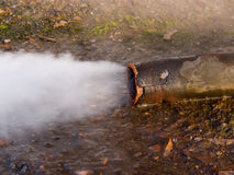 Emission of steam from a pipe. Steam emission under pressure from a pipe Royalty Free Stock Photos