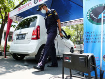 Emission tests. Transportation department officials conduct emission tests on vehicles in the streets of the city of Solo, Central Java, Indonesia Royalty Free Stock Photo