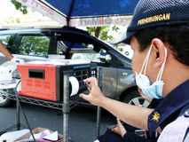 Emission tests. Transportation department officials conduct emission tests on vehicles in the streets of the city of Solo, Central Java, Indonesia Stock Images