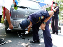 Emission tests. Transportation department officials conduct emission tests on vehicles in the streets of the city of Solo, Central Java, Indonesia Stock Photos