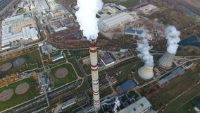 Emission to atmosphere from industrial pipes. Smokestack pipes shooted with drone. Aerial, close-up. stock footage