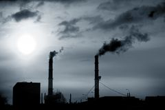 Emissions. Factory pipes smoke emissions in the sky royalty free stock photography