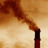 Emissions. Factory smoke emissions pipes in the sky royalty free stock image