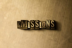 EMISSIONS - close-up of grungy vintage typeset word on metal backdrop Stock Photos