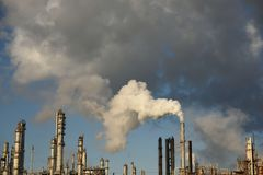 Emissions rising from the smoke stack of an industrial oil and gas refinery. In Corpus Christi, Texas, USA royalty free stock photos